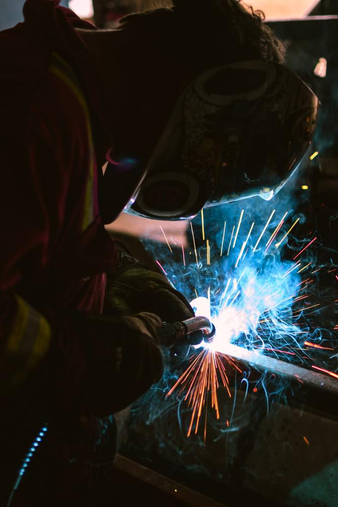 Colorful Photo of Man Welding