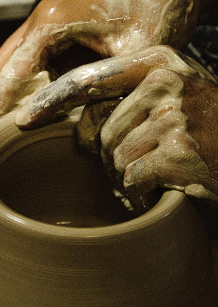 Potter Making A Clay Pot On A Potter's Wheel.